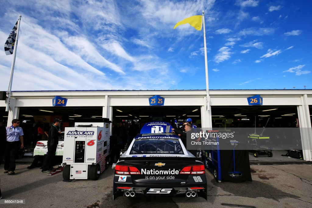 Crew members work on the #88 Nationwide Chevrolet during the Monster Energy NASCAR Cup Series Hollywood Casino 400 at Kansas Speedway on October 22, 2017 in Kansas City, Kansas.