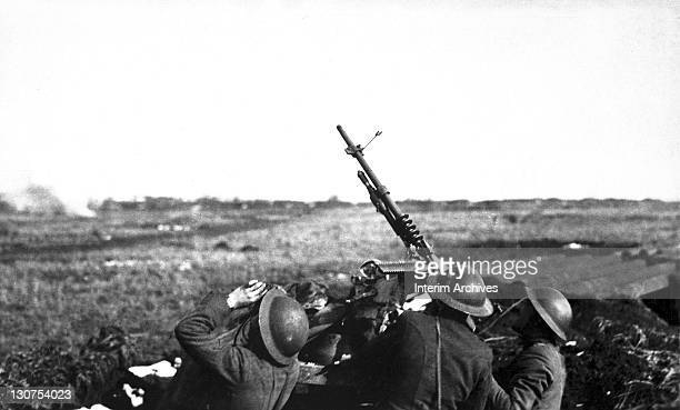 A crew of an antiaircraft machine gun from the 101st Field Artillery trains its guns upwards and fires upon a German observation plane at Plateau...