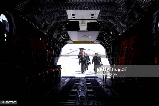 A crew of Boeing CH47 Chinook of Turkish Armed Forces walk to get on the helicopter during a press tour at Senior Lieutenant Gurcan Ulucan Airfield...