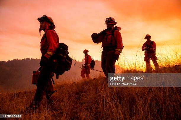 A crew of inmate firefighters make their way to firefighting operations to battle the Kincade Fire in Healdsburg California on October 26 2019 US...