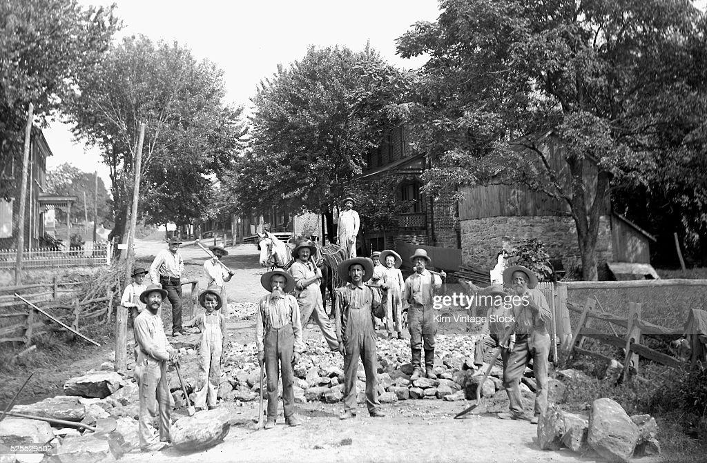 Workers construct a bridge/culvert over a creek, ca. 1890s. : News Photo