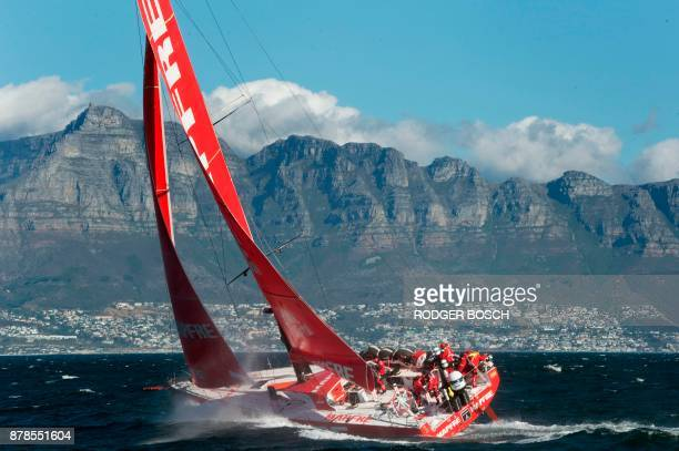 Crew of Mapfre a Spanish yacht sail into Table Bay to win the second leg of the Volvo Ocean Race 20172018 from Lisbon to Cape Town on November 24...