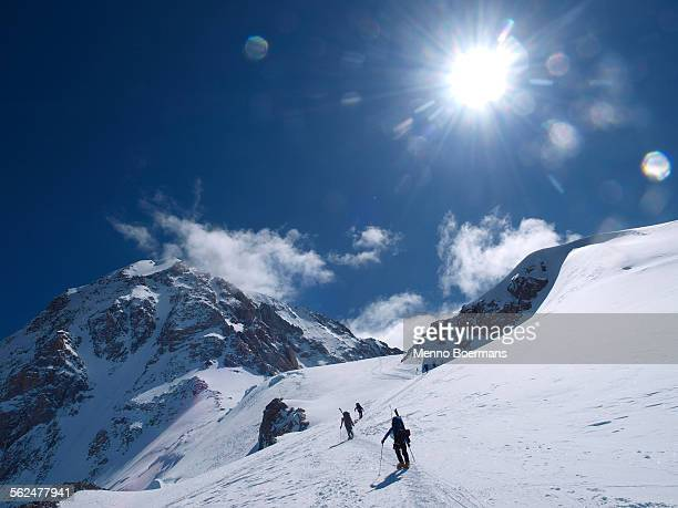 a crew of mountain rangers on it?s way to windy corner on mount mckinley, also know as denali, in alaska. - mt mckinley stock photos and pictures