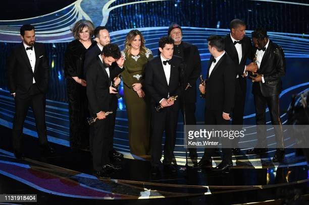 Crew of 'SpiderMan Into the SpiderVerse' accept the Animated Feature Film award onstage during the 91st Annual Academy Awards at Dolby Theatre on...