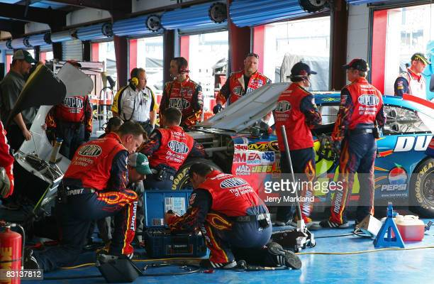Crew of the DuPont Chevrolet driven by Jeff Gordon makes repairs after crashing during the NASCAR Sprint Cup Series Amp Energy 500 at Talladega...