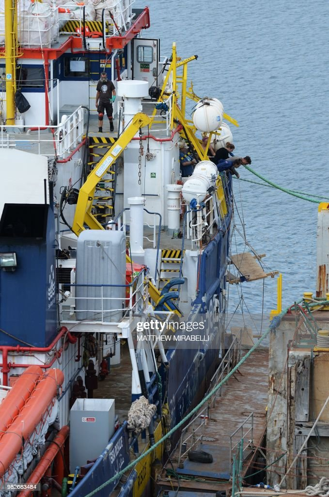 Crew of the Dutch search and rescue vessel Sea Watch 3 , work as
