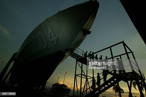 Crew of the HMAS Warrnambool leave the ship for the last time prior to it being decommissioned in Darwin The 24yearold ship was involved in border...
