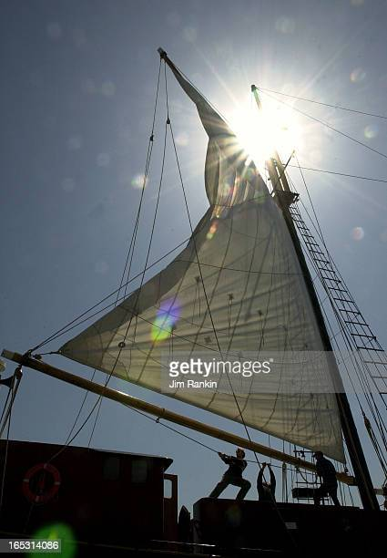 04/14/03 TORONTO Crew of the schooner Kajama docked at Toronto Harbourfront hoist her mizzen sail The crew spent the day readying the charter ship...