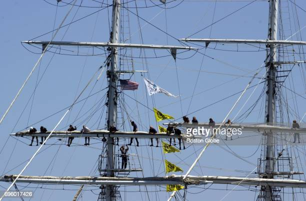 Crew of the tall ship Juan Sebastian de Elcano of Spain man the rigging as the ship makes her way into Boston Harbor during the Parade of Sail during...