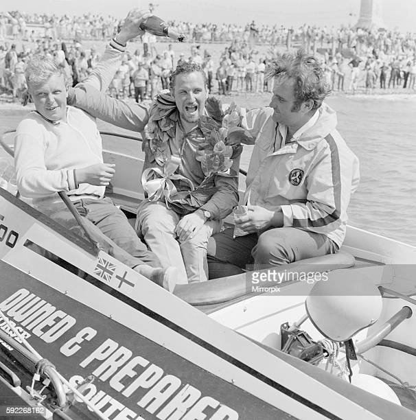 Crew of winning boat Avenger Too celebrate with champagne after winning Portsmouth leg of Round Britain Powerboat Race August 1969 Pictured Alan...