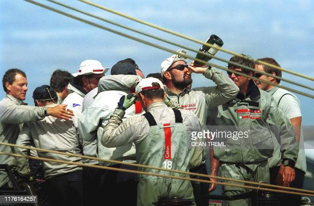 "Crew on board Italy's Prada Challenge yacht ""Luna Rossa"" celebrate their victory against ""America One"" on race day nine of the Louis Vuitton Cup..."