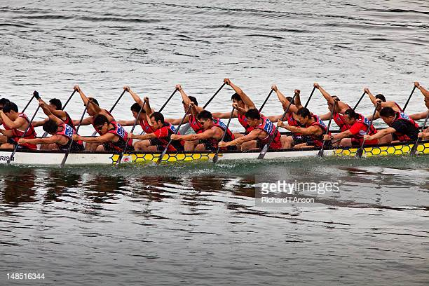 crew racing at penang international dragon boat festival. - crew dragon stock pictures, royalty-free photos & images