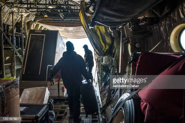Crew removing luggage at Chilean Base President Eduardo Frei Montalva on November 04 2019 in King George Island Antarctica