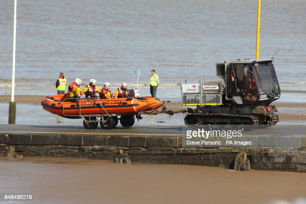 A RNLI crew return after undertaking a search at the scene in BurnhamonSea Somerset where the search for fouryearold Dylan Cecil from Kettering...