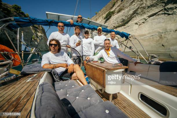 crew sailing on sailboat - yachting stock pictures, royalty-free photos & images