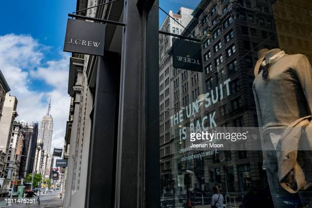 J Crew signage is seen on 5th Avenue on May 1 2020 in New York City Clothing apparel company J Crew is preparing to file for bankruptcy protection