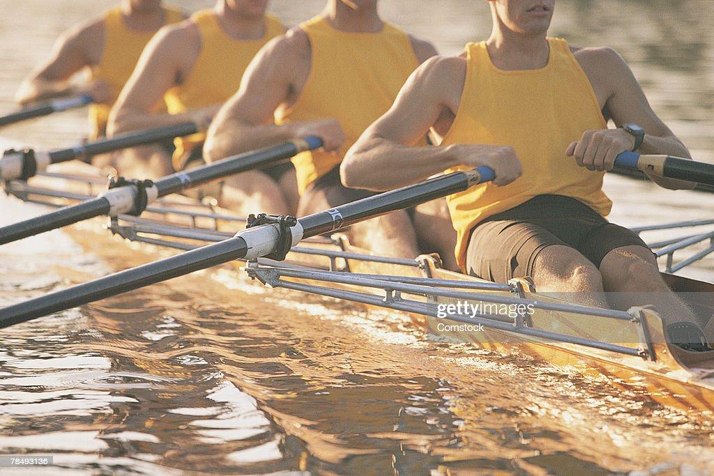 Crew team rowing a scull : Foto de stock