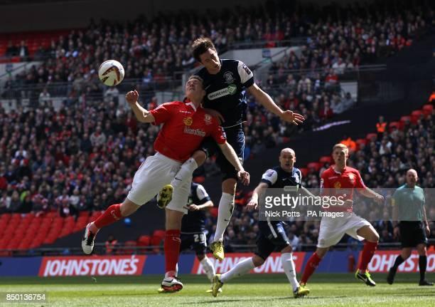 Crewe Alexandra's Mark Ellis and Southend United's Luke Prosser battle for the ball in the air