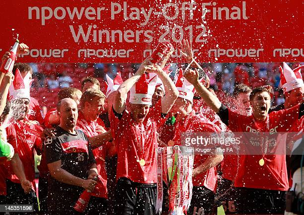 Crewe players celebrate promotion during the npower League Two Playoff Final match between Cheltenham Town and Crewe Alexandra at Wembley Stadium on...