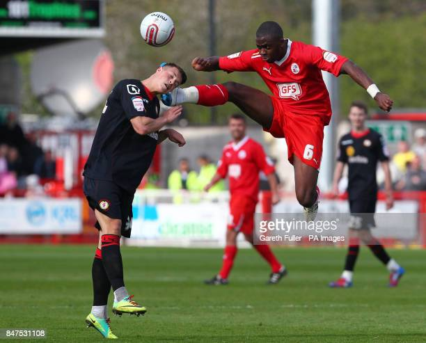 Crewe's Billy Bodin is challenged by Crawley's Hope Akpan during the npower Football League Two match at the Broadfield Stadium Crawley