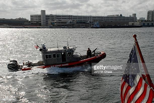Crewman mans machine gun aboard U.S. Coast Guard boat