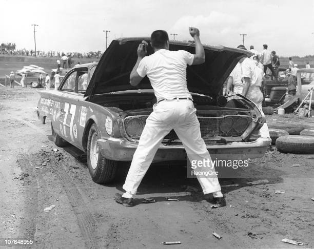 A crewman opens the hood of Marvin PanchÕs Ford after Panch retired on lap 11 during the Western North Carolina 500 NASCAR Cup race at...