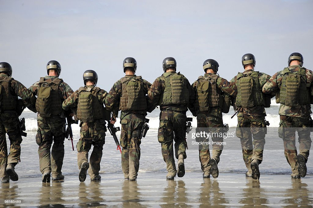 Crewman Qualification Training students hitting the surf before the start of medical training instru : Stock Photo