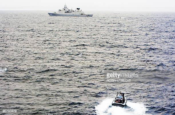 Crewmembers from the unseen vessel MV Irene motor towards Dutch warship HRMS Eversten on September 14 2009 in an unspecified region of the Indian...