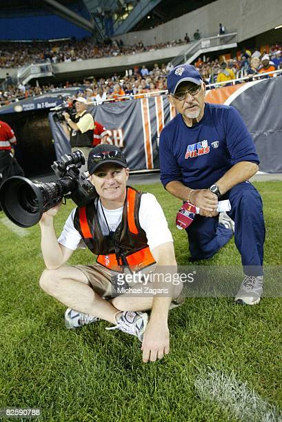 Crewmembers of NFL films work during the NFL game between the San Francisco 49ers and the Chicago Bears at Soldier Field on August 21 2008 in Chicago...