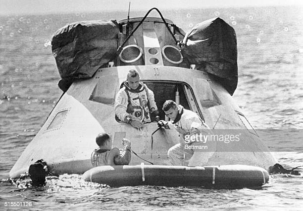 Crewmembers of the first manned Apollo space shot practice getting out of their spacecraft during egress training in the Gulf of Mexico 10/27 Command...