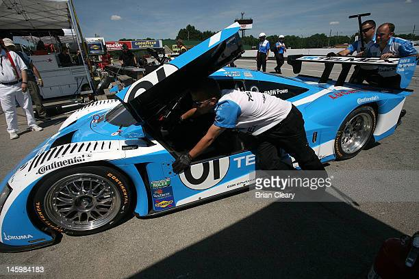 Crewmen for the BMW Riley of Scott Pruett and Memo Rojas push the car in the paddock before qualifying for the EMCO Gears Classic at MidOhio Sports...