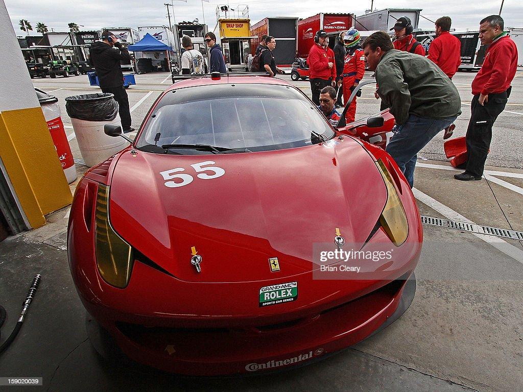 Crewmen prepare the #55 Ferrari 458 of Michael Waltrip, Robert Kauffman, Clint Bowyer and Rui Aguas in the paddock during preseason testing at Daytona International Speedway on January 5, 2013 in Daytona Beach, Florida.