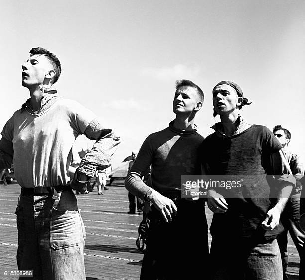 Crewmen watching planes return to the USS Lexington after a mission against Mili November 1943 | Location USS Lexington