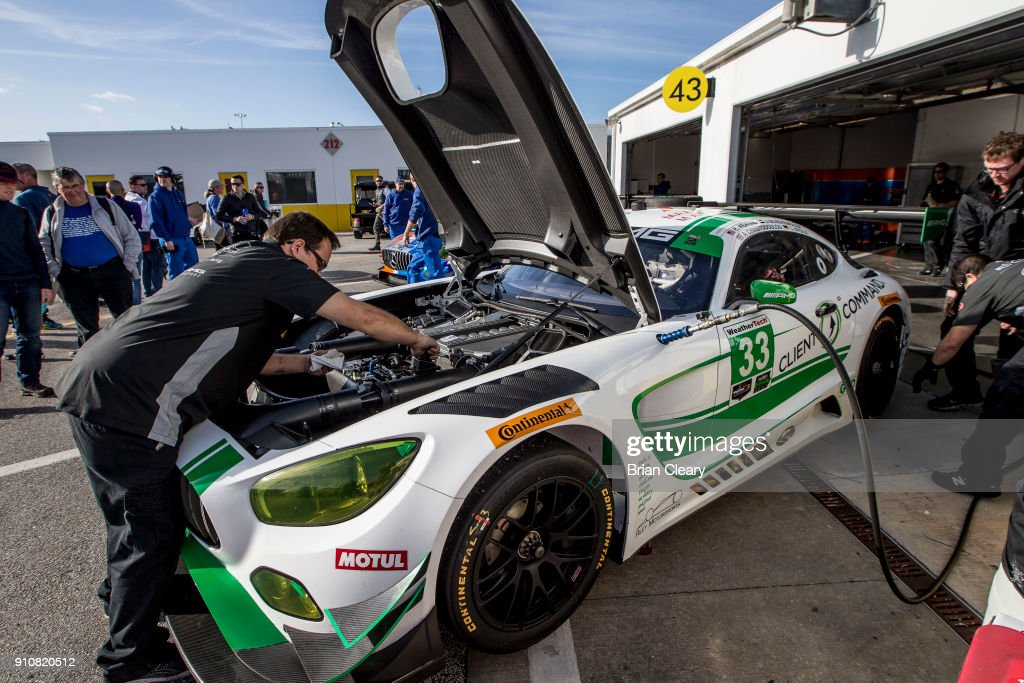 Crewmen work on the #33 Mercedes AMG GT3 in the garage before the Rolex 24 at Daytona at Daytona International Speedway on January 26, 2018 in Daytona Beach, Florida.