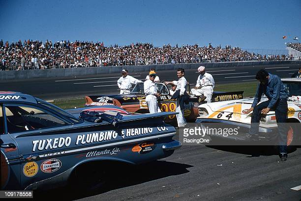 Crews await the start of the first Daytona 500 NASCAR Cup race at Daytona International Speedway Cars pictured are Bob WelbornÕs 1959 Chevrolet the...