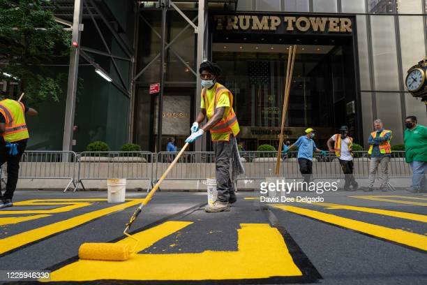 Crews begin painting a Black Lives Matter mural on Fifth Avenue directly in front of Trump Tower on July 9, 2020 in New York City. In a tweet,...
