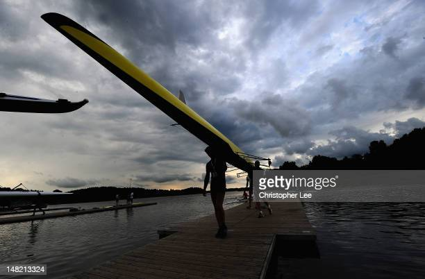 Crews bring their boats in as storm clouds gather during Day 2 of the 2012 FISA World Rowing U23 Championships on July 12, 2012 in Trakai, Lithuania.