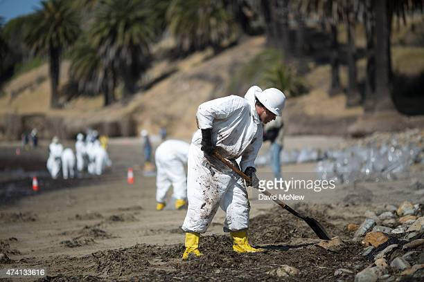 Crews clean oil from the beach at Refugio State Beach on May 20 2015 north of Goleta California About 21000 gallons spilled from an abandoned...