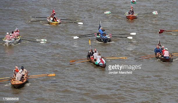 Crews compete in the annual 'Great River Race' a 22 mile rowing race on the River Thames from the Docklands to Richmond on September 7 2013 in London...