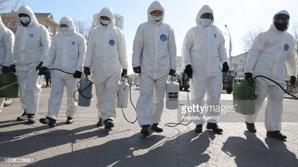 Crews disinfect streets stations and public places within measures taken against the spreading of coronavirus pandemic in Nur Sultan Kazakhstan on...