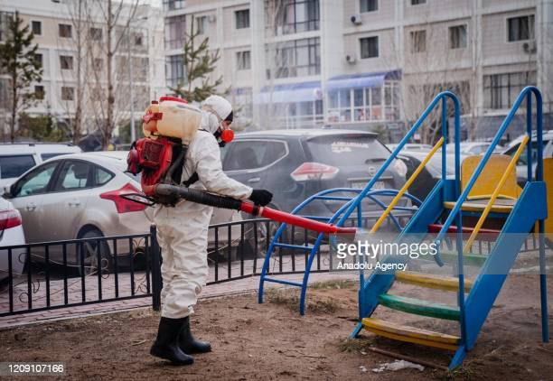 Crews disinfect streets, stations and public places within measures taken against the spreading of coronavirus pandemic in Nur Sultan, Kazakhstan on...