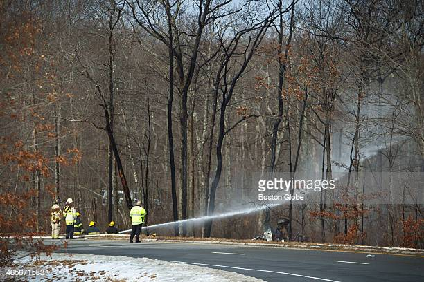 Crews extinguished the flames from a tanker truck rollover that closed all lanes of traffic both north and southbound on Route 24 in Fall River at...