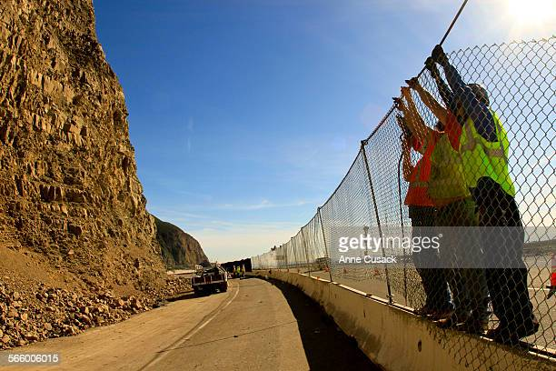 Crews from AIS Construction work to install fence at Sycarmore Canyon on PCH as recent storms brought beauty and the beast to Malibu beauty at the...