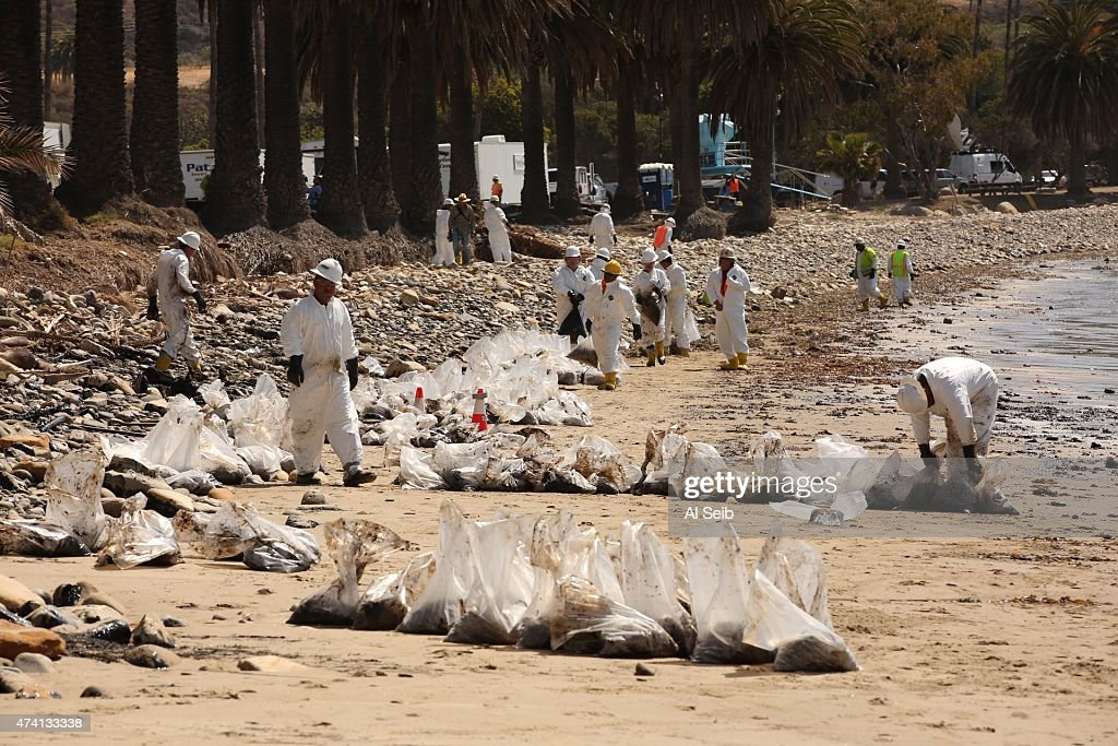 Crews from Patriot Cleanup bag oiled sand at Refugio State Beach Wednesday morning, May 20, 2015, after a ruptured pipeline near Santa Barbara leaked an estimated 21,000 gallons of crude oil.