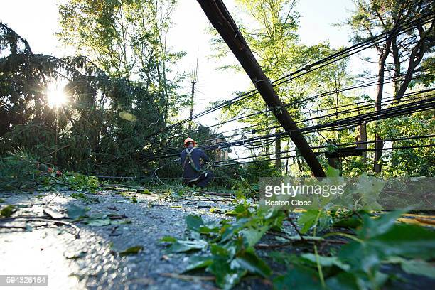 Crews from the Concord Light Department continue cleaning up downed trees and fallen power lines on Hawthorne Lane and Lexington Road in Concord Mass...
