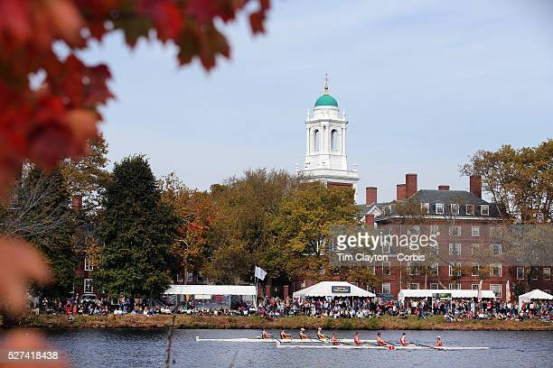 Crews in action during The 49th Head of the Charles Regatta on the Charles River which separates Boston and Cambridge, Massachusetts, USA. The Head...