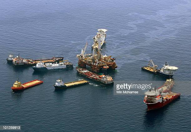 Crews on ships work on the attempted 'top kill' procedure at the source site of the Deepwater Horizon disaster on May 29 2010 in the Gulf of Mexico...