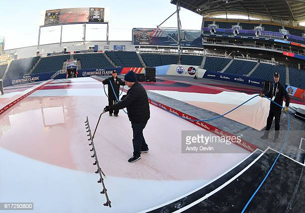 Crews prepare the ice in advance of the 2016 Tim Hortons NHL Heritage Classic alumni game at Investors Group Field on October 22 2016 in Winnipeg...