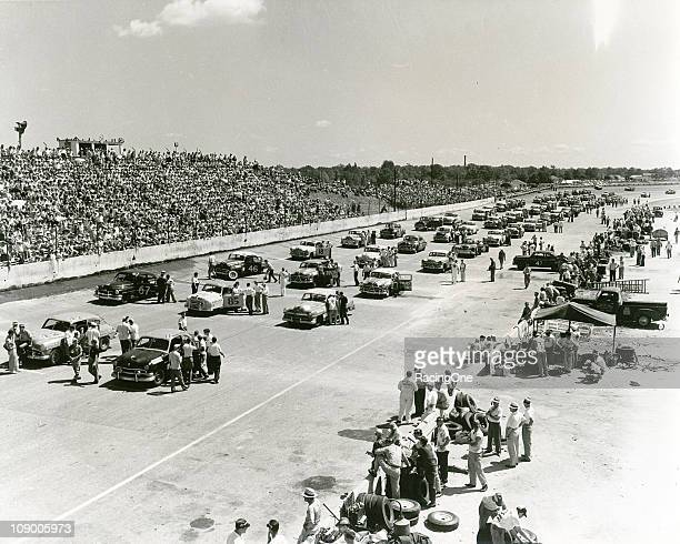 Crews prepare their cars along the starting grid before the Southern 500 NASCAR Cup race at Darlington Raceway Fireball RobertsÕ Ford started from...