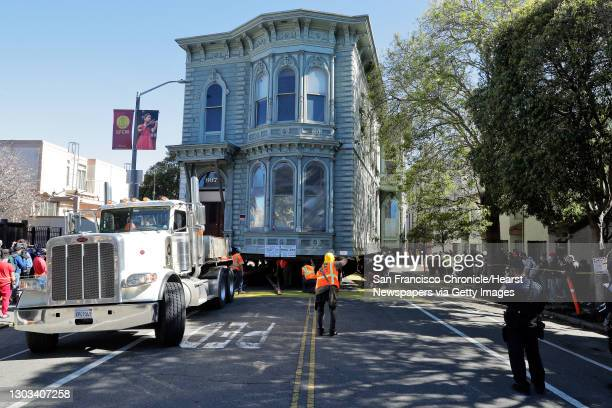 Crews prepare to move the home into the lot next to the former Bryant Mortuary as the two-story Victorian home is relocated from 807 Franklin Street...